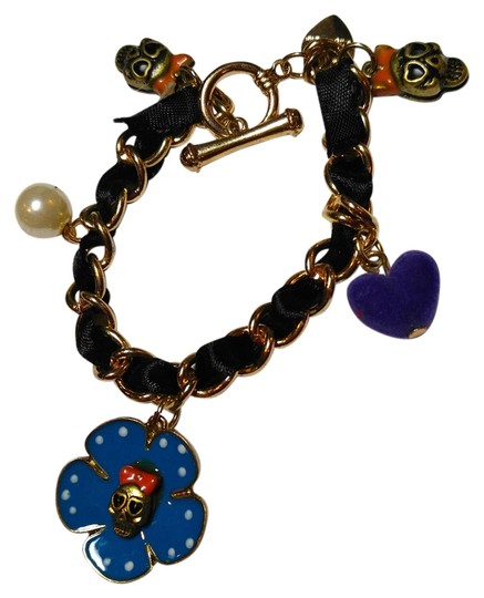 Preload https://img-static.tradesy.com/item/9058240/betsey-johnson-black-gold-blue-purple-skull-flower-charm-j1514-bracelet-0-3-540-540.jpg