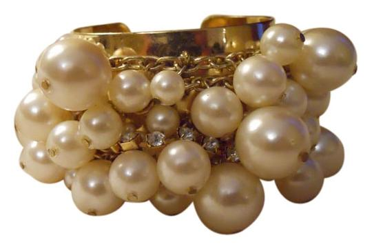 Preload https://item1.tradesy.com/images/gold-wide-faux-pearl-and-rhinestone-cuff-bracelet-9091030-0-2.jpg?width=440&height=440