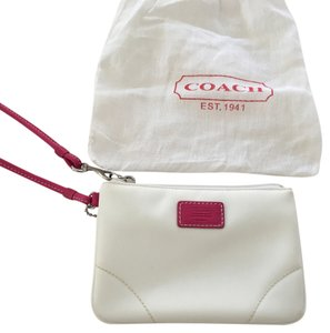 Coach Wristlet in White with pink label and strap