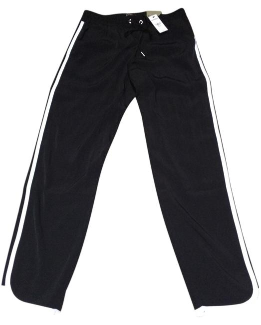 Preload https://img-static.tradesy.com/item/9134455/express-black-and-white-drapey-soft-relaxed-trousers-size-2-xs-26-0-3-650-650.jpg