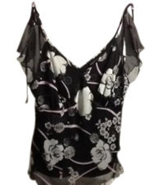 Preload https://item1.tradesy.com/images/torrid-black-and-white-frilly-blouse-size-10-m-9140-0-0.jpg?width=400&height=650