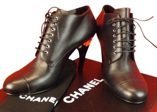 Preload https://img-static.tradesy.com/item/9148081/chanel-black-leather-lucite-pearl-heel-lace-up-ankle-bootsbooties-size-eu-405-approx-us-105-regular-0-1-540-540.jpg