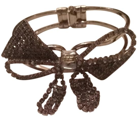 Preload https://item5.tradesy.com/images/juicy-couture-rhinestone-bow-bracelet-917904-0-0.jpg?width=440&height=440