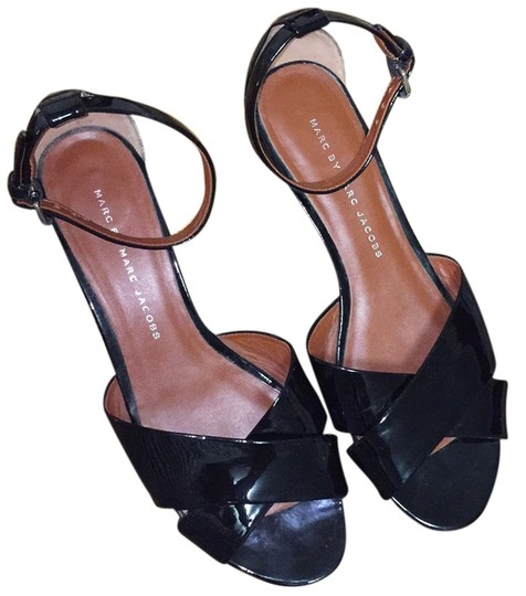 Preload https://img-static.tradesy.com/item/9192910/marc-by-marc-jacobs-black-patent-strappy-wedge-sandals-size-us-75-regular-m-b-0-1-540-540.jpg