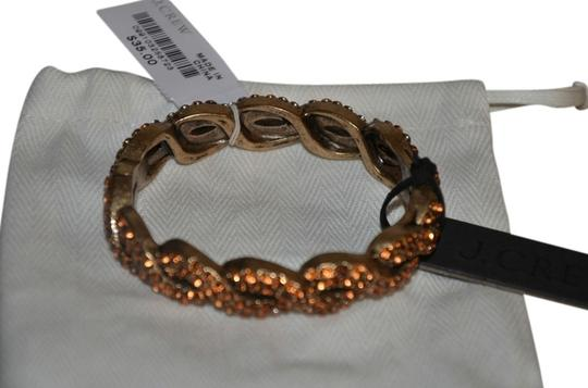 Preload https://item4.tradesy.com/images/jcrew-brown-gold-braided-pave-with-dust-bag-out-bracelet-920553-0-0.jpg?width=440&height=440