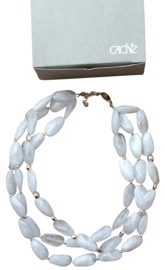 Preload https://item4.tradesy.com/images/cache-white-three-strand-bead-necklace-920558-0-0.jpg?width=440&height=440