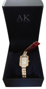 AK Anne Klein Brand new beautiful mother of pearl face, with crystal bezel, gold band with crystals. Great for everyday or going out.