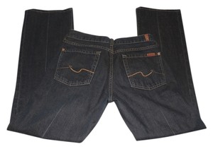 Preload https://item5.tradesy.com/images/7-for-all-mankind-dark-blue-rinse-by-jerome-dahan-boot-cut-jeans-size-28-4-s-925819-0-0.jpg?width=400&height=650