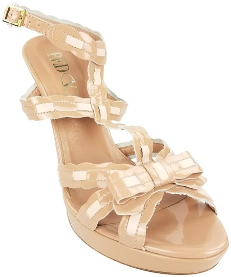 Preload https://img-static.tradesy.com/item/926713/red-valentino-nude-bow-scalloped-lace-sandals-size-us-95-regular-m-b-0-2-540-540.jpg