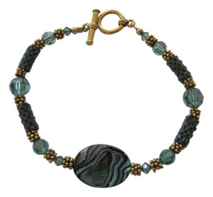 Hand Made by San Francisco Bay Area Artist Hand Made SWAROVSKI Crystal Beaded with Gold Plated Fittings