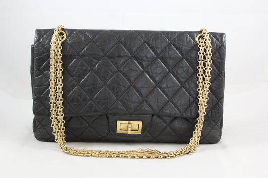 Preload https://item2.tradesy.com/images/chanel-255-reissue-quilted-double-flap-black-leather-tote-928621-0-0.jpg?width=440&height=440