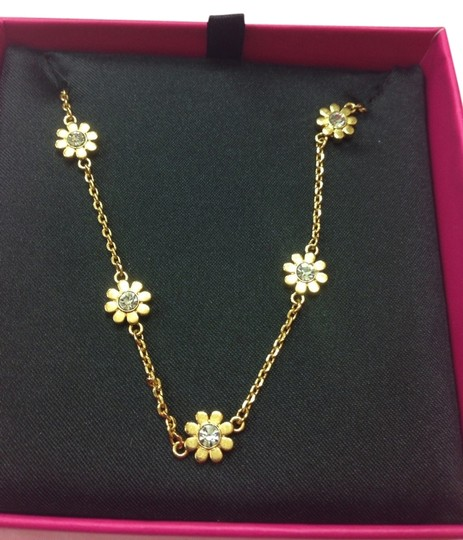 Preload https://item2.tradesy.com/images/juicy-couture-yellow-gold-daisy-mini-necklace-yjru7766-931066-0-0.jpg?width=440&height=440