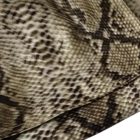 Preload https://item3.tradesy.com/images/coco-and-lolly-clutch-python-print-931407-0-0.jpg?width=440&height=440