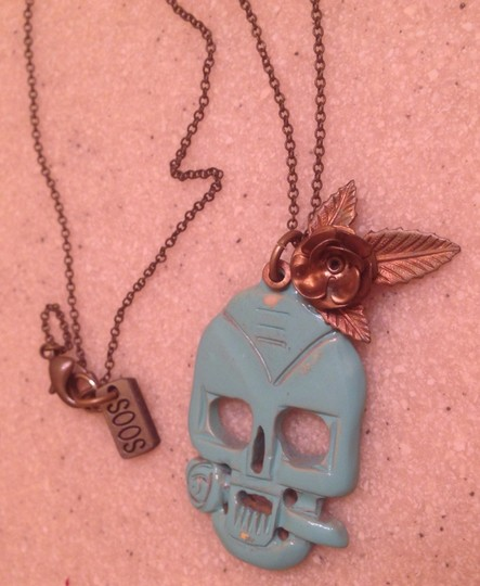 Preload https://item1.tradesy.com/images/turquoisegold-skull-and-rose-934650-0-0.jpg?width=440&height=440