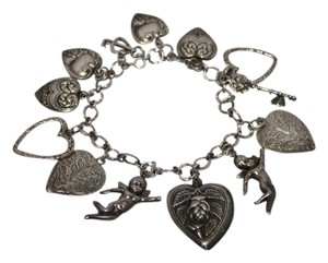 Other Victorian Repousse Charm Bracelet w/Hearts and Cherubs, 8inch .925 SS