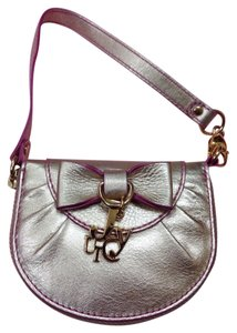 Juicy Couture Wristlet in Yellow Gold With Pinkish Purpla Lining