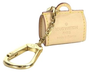 Louis Vuitton Wristlet in Nude