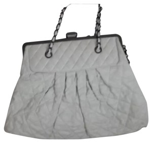 Chanel Limited Edition White Leather quilted lambskin jumbo bag. Has woven chain handles and a long strap. In excellent condition - no rips tears or stains. Modern pewter color metal - top clasp closure with CC's Shoulder Bag