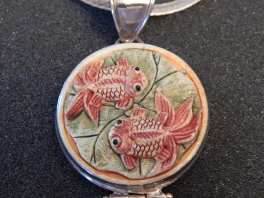 Other Pendant in sterling silver.