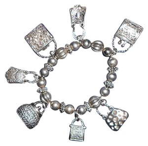 Other Silver tone purse charm bracelet... Stretch Bracelet