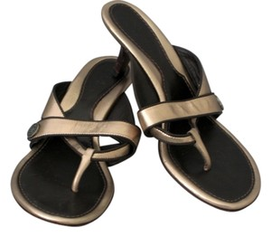 Cole Haan Gold w dark brown trim Sandals