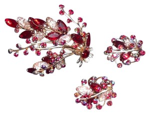 Other Vintage pin and clip on earrings.. Each stem moves.. Gold Tone with Reds and blues and pinks. Beautiful Rhinestones