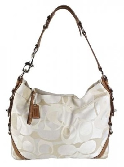 Preload https://item2.tradesy.com/images/coach-carly-champagne-cream-tan-leather-and-canvas-shoulder-bag-9506-0-0.jpg?width=440&height=440