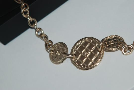 Chanel CHANEL 1 $1825 METAL GOLD TONE BELT W/QUILTED MEDALLIONS CC