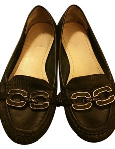 Coach Beautiful soft leather in great condition. Soles show sign of wear, but heels and leather are in good shape. Inside the shoe the coach insignia is worn, but slightly visible. Flats