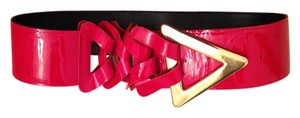 Red patent leather belt with gold triangle buckle and braid detail
