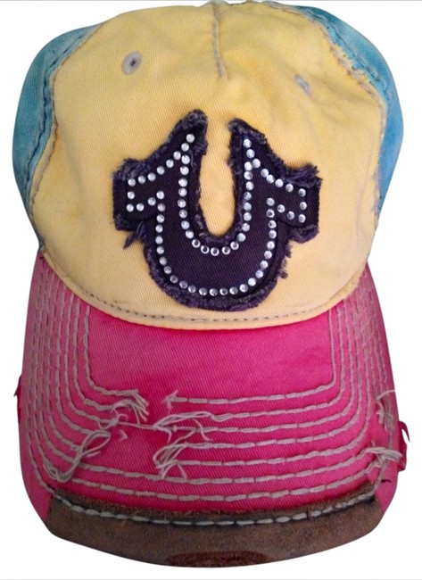 Item - Blue Pink and Yellow with White Stitching and Brown On The Back and Brim. The Horse Shoe On The Front Is A Charcoal It Distressed Hat