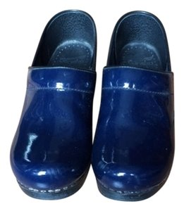 Dansko navy patent leather Mules