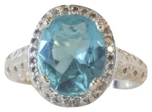 Other Ocean Blue Topaz with crystal halo settings