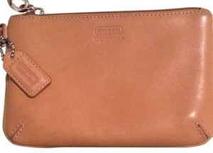 66f4066e3972 Added to Shopping Bag. Coach Wristlet in Camel. Coach Camel Leather Wristlet
