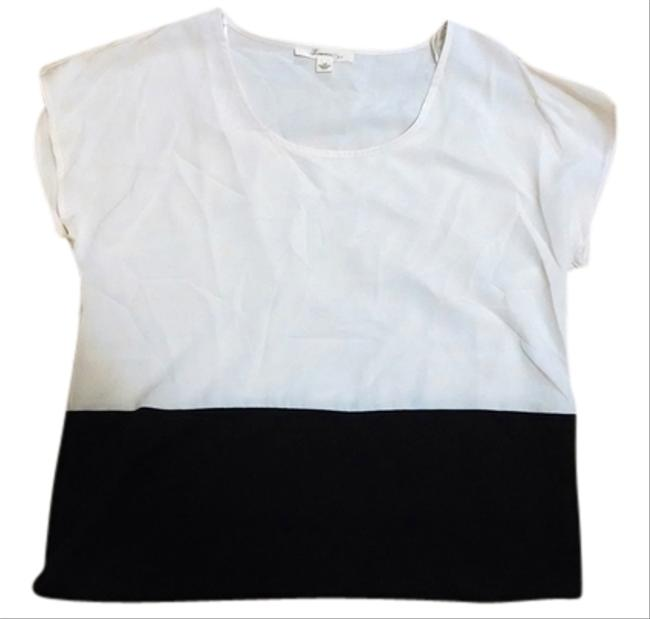 Preload https://item1.tradesy.com/images/forever-21-white-and-black-blouse-size-6-s-960215-0-0.jpg?width=400&height=650