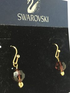 Swarovski 14 kt gold french hook style back with brown facetedc