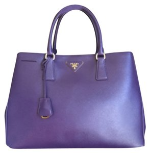 53ae2ef02229 ... cheap added to shopping bag. prada lux saffiano tote in purple 7aced  2e3bc