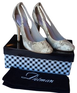 Delman Cream Pumps