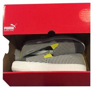 Puma Grey and white stripes with yellow accents Athletic