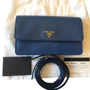a5f305f75878 Added to Shopping Bag. Prada Saffiano Cross Body Bag. Prada Lux Saffiano  Mini Blue Leather ...