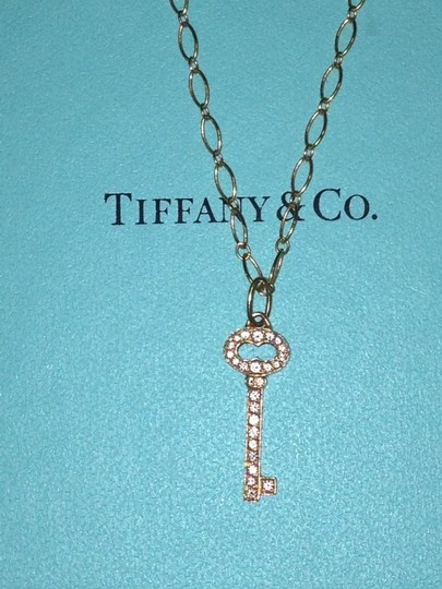 Preload https://item3.tradesy.com/images/tiffany-and-co-rose-gold-vintage-oval-key-charm-and-chain-963952-0-0.jpg?width=440&height=440