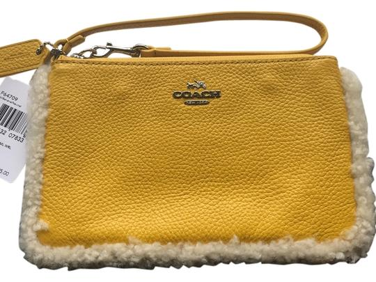 Preload https://item2.tradesy.com/images/coach-small-and-shearling-f64709-banana-neutral-leather-wristlet-9641776-0-1.jpg?width=440&height=440