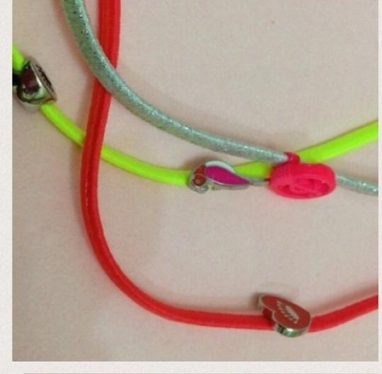 Juicy Couture Juicy Couture Set of Three Headbands Elastic head bands in yellow, orange and silver