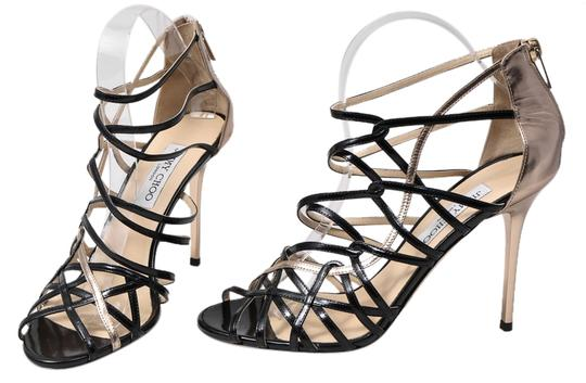 Preload https://item4.tradesy.com/images/jimmy-choo-blackgold-fiscal-strappy-woven-leather-sandals-size-us-95-regular-m-b-9644008-0-1.jpg?width=440&height=440