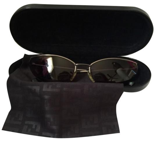 Preload https://item2.tradesy.com/images/fendi-dark-ruthenium-1563-small-cat-eye-sunglasses-9651796-0-1.jpg?width=440&height=440