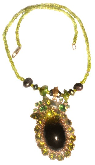 Preload https://item1.tradesy.com/images/greens-big-black-stone-pearls-rhinestones-with-real-18-free-shipping-necklace-9651895-0-1.jpg?width=440&height=440