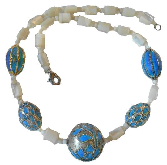 Preload https://item2.tradesy.com/images/mother-of-pearl-and-silver-and-blue-18-blue-middle-bead-1-necklace-9652381-0-2.jpg?width=440&height=440