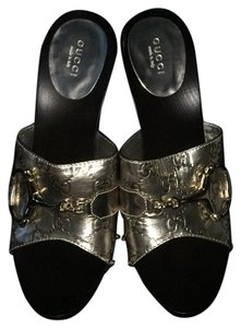 Gucci Brown and silver Platforms