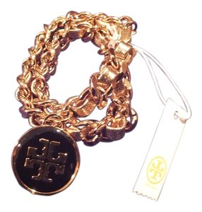 aa2b142e817f28 Tory Burch Tory Burch Metallic Leather and Chain Double Wrap Bracelet in  Gold Black