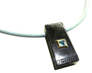 Black Etched Onyx With 14 Karat gold & Blue Topaz on Light Blue Leather Cord